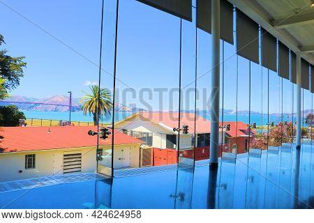 June 7, 2021 In San Francisco, Ca:  Large Modern Glass Windows Overlooking The San Francisco, Ca Bay