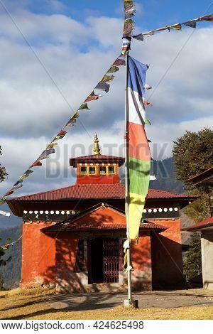Bupsa Buddhist Gompa Monastery With Prayer Flags Near Lukla And Kharikhola Village, Khumbu Valley, E