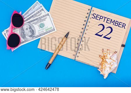22nd Day Of September. Travel Concept Flat Lay - Notepad With The Date Of 22 September Pen, Glasses,