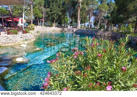 Many People Walk And Swim In The Cleopatra Pool.