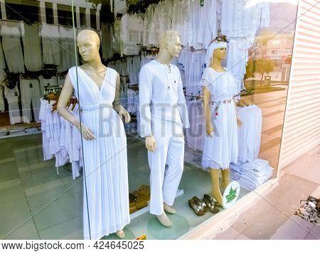 Antalya, Turkey - May 11, 2021: The White Cotton Clothes - Dress, Blouses, Pants At Shop Or Store At