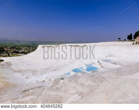Travertines In Turkey. Calcite Cliff Of Pamukkale At Sunny Day.