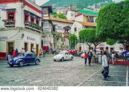 Taxco, Mexico - September 12, 2002: Scene Of The Historic Center, With Local Transport, Locals And V
