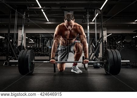 Athlete, Man Doing Deadlift With A Barbell Young Athlete Preparing For A Heavy Weight Barbell Liftin