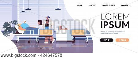 Nurse Taking Care Of Sick Senior Man Patient Lying In Hospital Bed Care Service Concept Horizontal