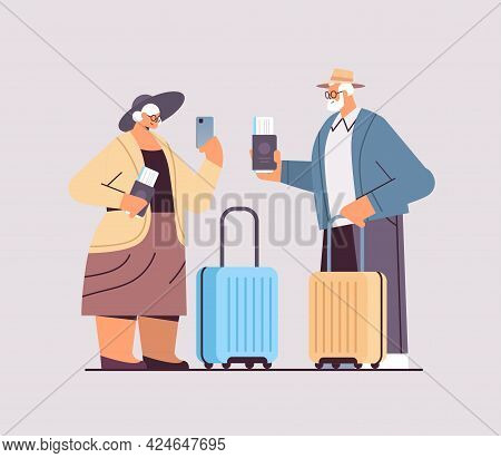 Elderly Couple Of Tourists Grandparents With Luggage Passports And Tickets Ready To Boarding At Airp