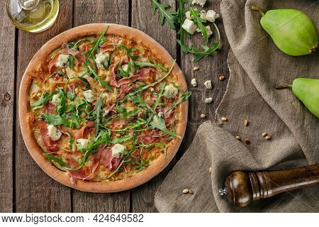 Pizza With Cured Ham, Pear, Blue Cheese, Pine Nuts, Arugula