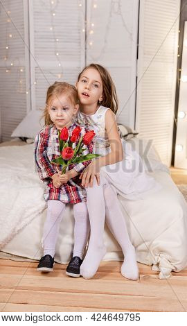 Two Cute Little Girls Are Hugging. Friendship Sisters. Two Beautiful Child Sisters Embracing At Home