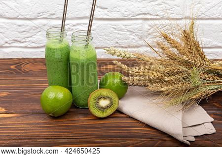 Green Detox Smoothie For Weight Loss. Spinach Milkshake On A Light Background. Fresh Green Smoothie
