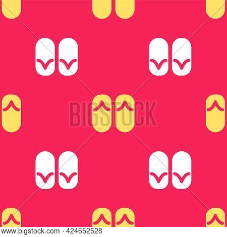 Yellow Flip Flops Icon Isolated Seamless Pattern On Red Background. Beach Slippers Sign. Vector