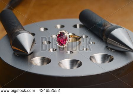 Luxury Golden Ring With Ruby Gemstone And Bezel Blocks On Jewelers Desktop. Workplace Of A Jeweler.