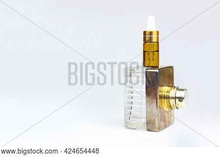 Serum In Glass Bottle With Pipette And Perfume Spray Bottle. Layout Stack Of Two Unbranded Cosmetic