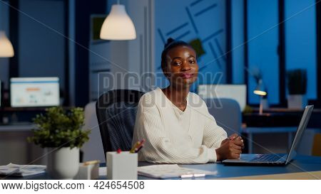 Tired Black Woman Manager Looking At Camera Sighing After Typing On Laptop, Working Late At Night In