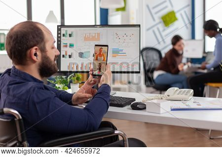 Disabled Businessman Entrepreneur Discussing With Colleagues During Video Call.employee Sitting Immo