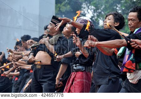 Banten, Indonesia - August 8, 2014 : The Participants Are Doing A Debus Action At The Banten Debus F