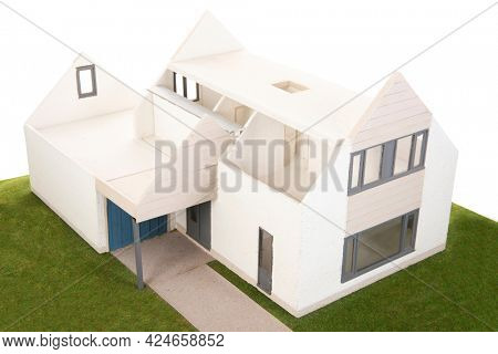 Miniature house with furniture isolated over white background