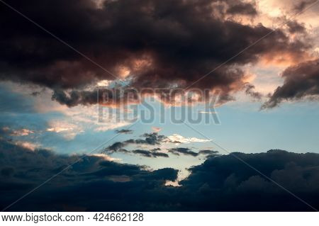 Colorful Sunset And Dark Cloudy Sky . Dramatic Sunset In Worm Tone