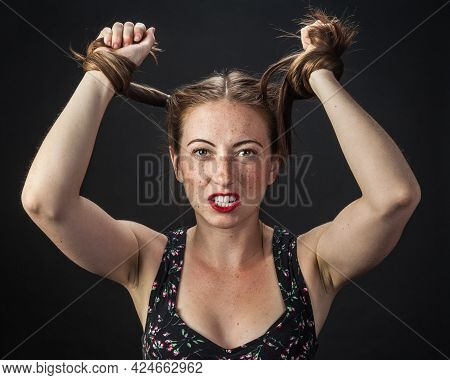 Young Woman Pulling Her Hair In Frustration