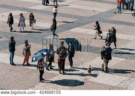 Madrid, Spain - April, 18 2021: Free Tour Guides With Umbrellas In Plaza Mayor Square In Central Mad