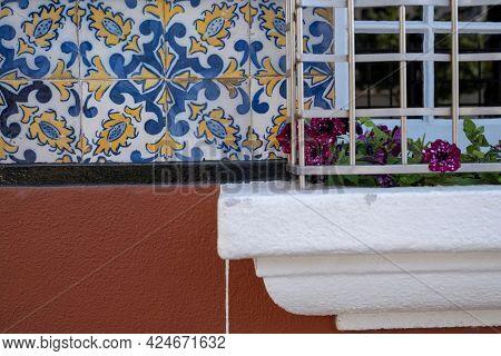Traditional old tiles wall on the street Portuguese, azulejos ceramic tilework. Porto, Portugal.