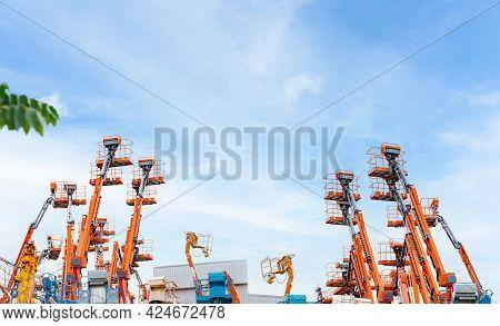 Articulated Boom Lift. Aerial Platform Lift. Telescopic Boom Lift Against Blue Sky. Mobile Crane Par