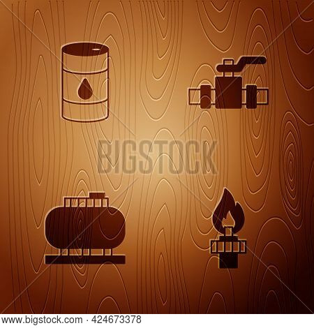 Set Oil Rig With Fire, Barrel Oil, Tank Storage And Metallic Pipes And Valve On Wooden Background. V