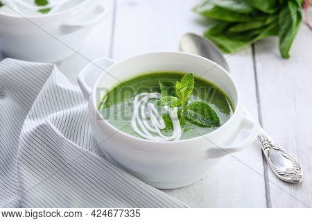 Spinach Puree Soup Seasoned With Cream And Mint