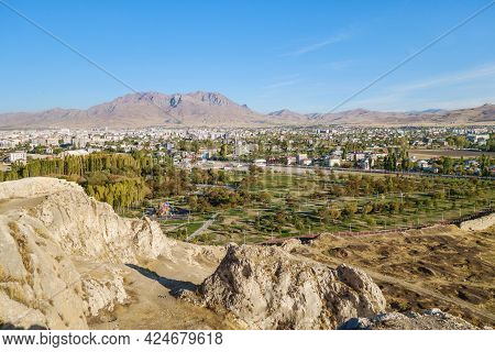 View From Wall Of Van Fortress On Walking Park & Modern Van (turkey) Behind It. There Are Ruins Of A