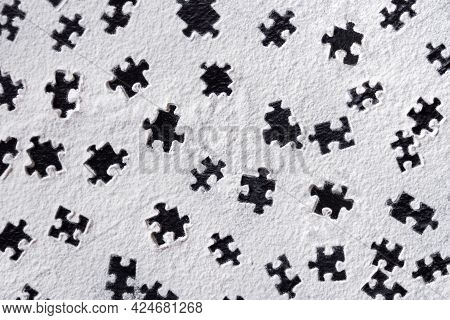 Puzzle Shapes Pattern Printed On White Flour Sand, Powder On Dark Table. Natural, Organic Background