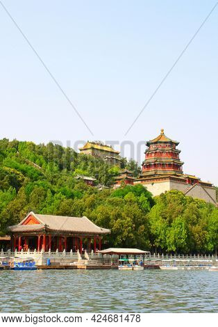 Beautiful landscape with Imperial Summer Palace on hill, Beijing, China. UNESCO world heritage site. View from Kunming (Kunming-Hu) lake