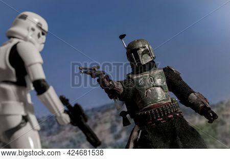 JUNE 23 2021:  Scene from Disney Plus Star Wars The Mandalorian - The Tragedy - Bounty Hunter Boba Fett in action - custom Hasbro action figure