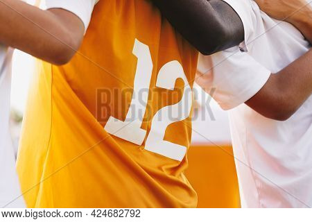 Multiracial Sports Team Members United. Closeup Image Of Soccer Shirt Back Side. Footballers Standin