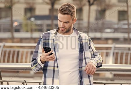 Your True Companion. Handsome Man Use Phone Outdoors. Online Chatting. Sms Message. Mobile Phone Mes