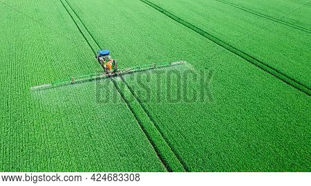 Application Of Water-soluble Fertilizers, Pesticides Or Herbicides In The Field. View From The Drone