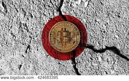 Bitcoin Crypto Currency Coin With Cracked Japan Flag. Crypto Restrictions