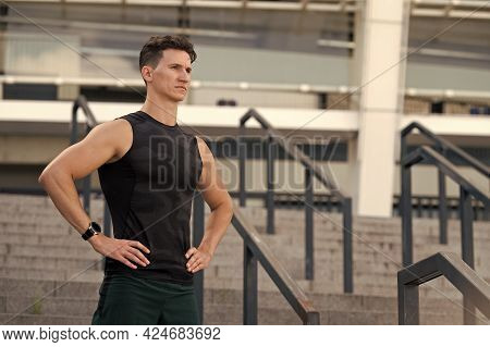 Mind And Body In Harmony. Healthy Lifestyle. Countdown Timer. Urban Runner Man With Sports Watch. Sp