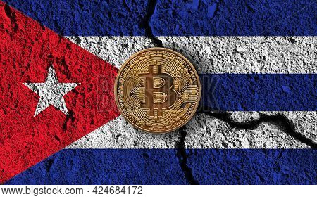 Bitcoin Crypto Currency Coin With Cracked Cuba Flag. Crypto Restrictions