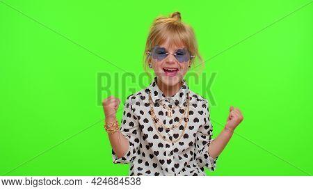 Little Blonde Teen Child Kid Girl In White Black Shirt Celebrate Success Win Scream Rejoices Doing W