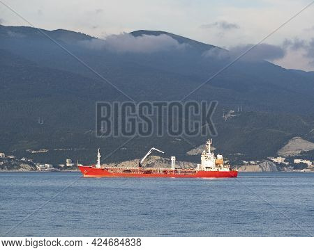 Bunker Barge Or Fuel Vessel Sailing On Water. Industrial Ship