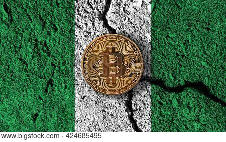 Bitcoin Crypto Currency Coin With Cracked Nigeria Flag. Crypto Restrictions