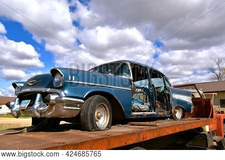 Lidgerwood, North Dakota, May 9, 2021:  The Wrecked Car On A Truck Bed Is A 1957 Chevy, A Classic Pr