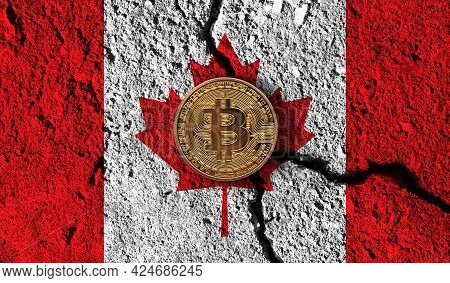 Bitcoin Crypto Currency Coin With Cracked Canada Flag. Crypto Restrictions