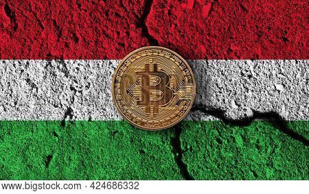 Bitcoin Crypto Currency Coin With Cracked Hungary Flag. Crypto Restrictions