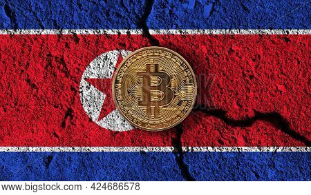 Bitcoin Crypto Currency Coin With Cracked North Korea Flag. Crypto Restrictions