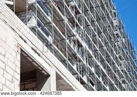 Apartment Building Under Construction Against Blue Sky.