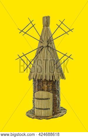 Straw Mill On An Isolated Yellow Background. Old Windmill, Mill As Background With Space For Text