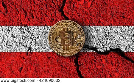 Bitcoin Crypto Currency Coin With Cracked Austria Flag. Crypto Restrictions