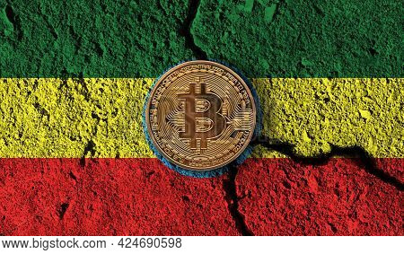 Bitcoin Crypto Currency Coin With Cracked Ethiopia Flag. Crypto Restrictions