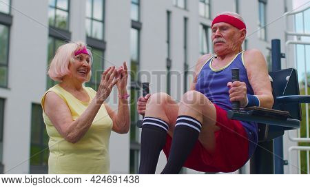 Senior Man Grandfather Doing Training Abs Workout Exercising On Playground. Sport Motivation Concept