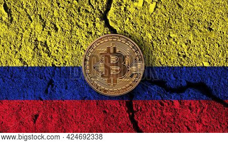 Bitcoin Crypto Currency Coin With Cracked Colombia Flag. Crypto Restrictions